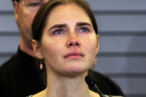File photo of Amanda Knox pauses while speaking during a news conference on arrival from Italy
