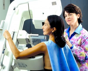 1280px-Woman_receives_mammogram_(1)- Creative Commons